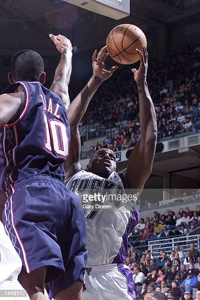 Anthony Mason of the Milwaukee Bucks rebounds the ball against Derrick Dial of the new Jersey Nets during the NBA game at the Bradley Center in...