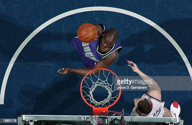 Anthony Mason of the Milwaukee Bucks shoots over Aaron Williams of the New Jersey Nets in Game five of the Eastern Conference Quarterfinals during...