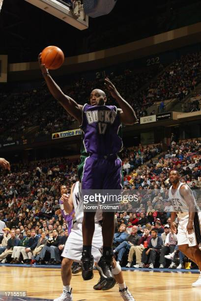 Anthony Mason of the Milwuakee Bucks pulls down a rebound during the NBA game against the New Jersey Nets at Continental Airlines Arena on December...
