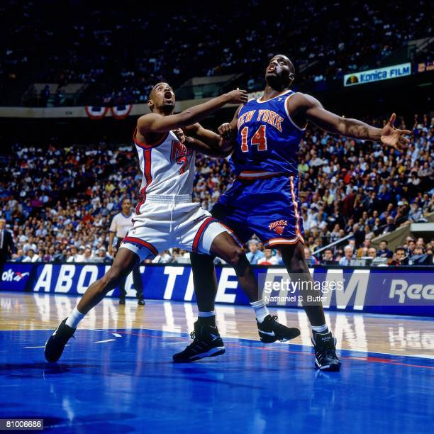 Anthony Mason of the New York Knicks and Kenny Anderson of the New Jersey Nets battle for position in Game Three of the Eastern Conference...