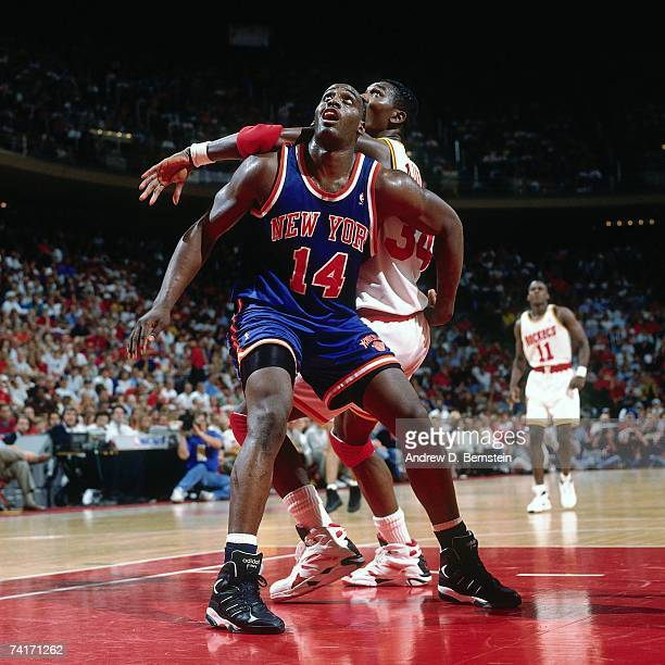 Anthony Mason of the New York Knicks boxes out against Hakeem Olajuwon of the during Game Two of the NBA Finals played on June 10, 1994 at The Summit...