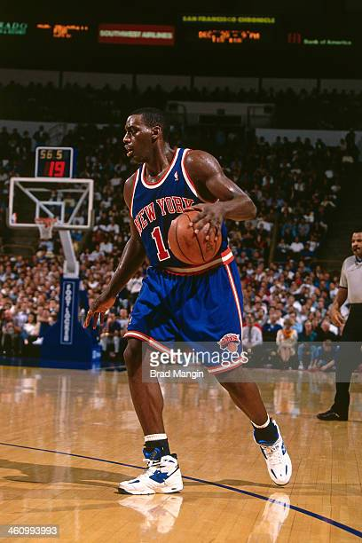 Anthony Mason of the New York Knicks dribbles the ball during a game played circa 1996 at Oakland-Alameda County Coliseum in Oakland, California....
