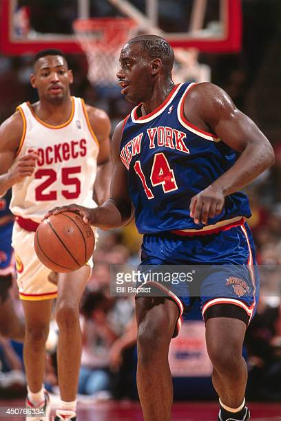 Anthony Mason of the New York Knicks dribbles the ball during Game One of the NBA Finals against the Houston Rockets on June 8, 1994 at The Summit in...
