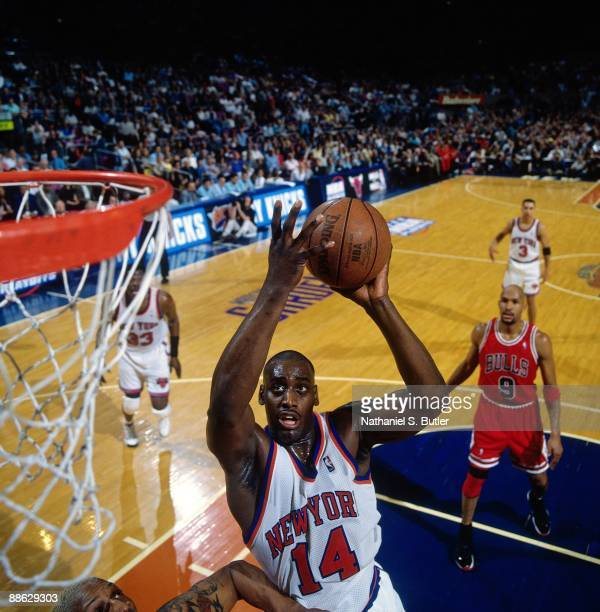 Anthony Mason of the New York Knicks goes up for a shot against Dennis Rodman of the Chicago Bulls in Game Three of the Eastern Conference Semifinals...