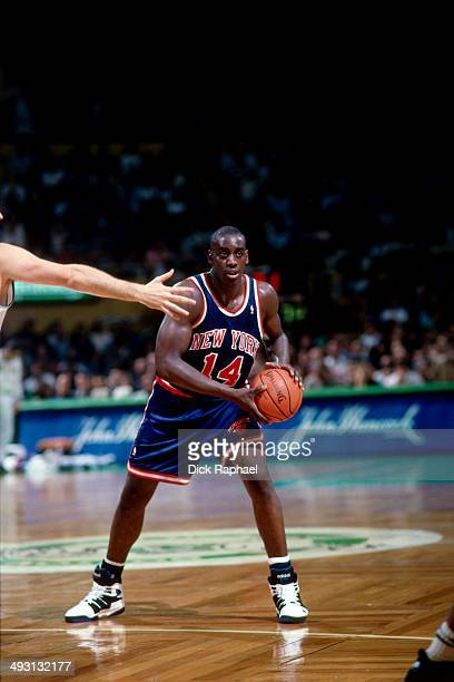 Anthony Mason of the New York Knicks handles the ball against the Boston Celtics during a game played circa 1994 at the Boston Garden in Boston,...