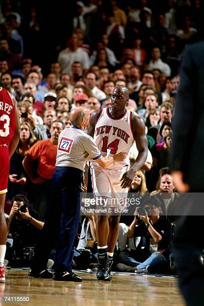Anthony Mason of the New York Knicks is held back by the referee during Game Five of the NBA Finals played on June 17 1994 at Madison Square Garden...