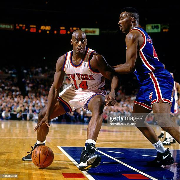 Anthony Mason of the New York Knicks makes a move to the basket against Armon Gilliam of the New Jersey Nets in Game One of the Eastern Conference...