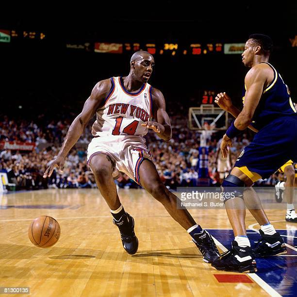 Anthony Mason of the New York Knicks moves the ball against Byron Scott of the Indiana Pacers in Game Seven of the Eastern Conference Finals during...