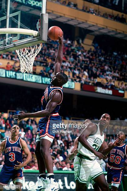 Anthony Mason of the New York Knicks rises for a dunk against the Boston Celtics during a game played at the Boston Garden in Boston, Massachusetts...