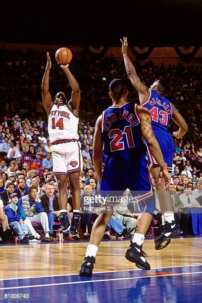 Anthony Mason of the New York Knicks shoots a jump shot against Armon Gilliam of the New Jersey Nets in Game Two of the Eastern Conference...