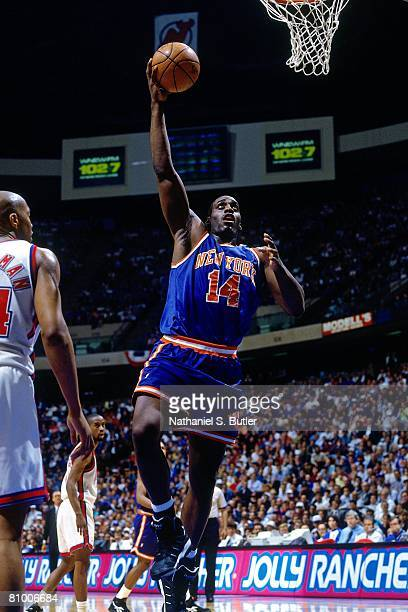 Anthony Mason of the New York Knicks shoots a layup against Derrick Coleman of the New Jersey Nets in Game Three of the Eastern Conference...