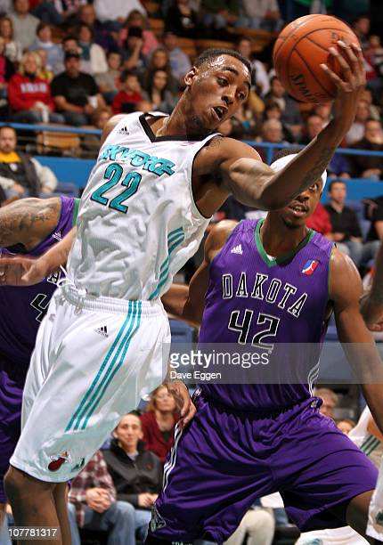 Anthony Mason of the Sioux Falls Skyforce pulls down a rebound in front of Walter Sharpe of the Dakota Wizards in the first half of their game...