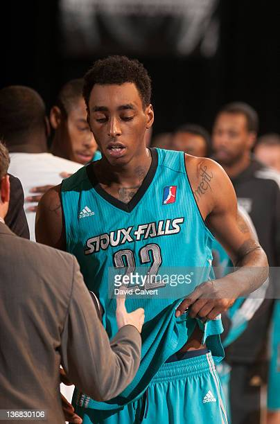 Anthony Mason of the Sioux Falls Skyforce shakes hands with members of the Texas Legends following their game at the 2012 NBA D-League Showcase on...