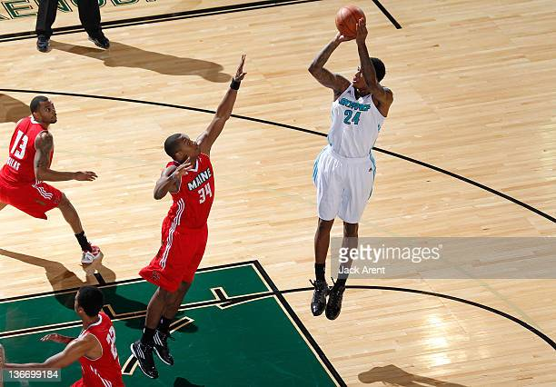 Anthony Mason of the Sioux Falls Skyforce shoots the ball against Justin Brownlee the Maine Red Claws during the 2012 NBA D-League Showcase on...