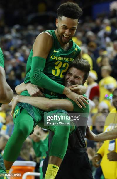 Anthony Mathis of the Oregon Ducks celebrates a 71-70 overtime win over the Michigan Wolverines at Crisler Arena on December 14, 2019 in Ann Arbor,...