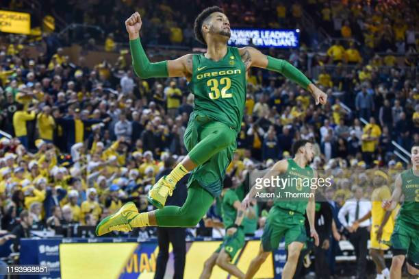 Anthony Mathis of the Oregon Ducks celebrates during the second half of a college basketball game at The Crisler Center on December 14 2019 in Ann...