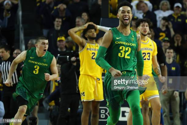 Anthony Mathis of the Oregon Ducks reacts to a 7110 overtime win against the Michigan Wolverines at Crisler Arena on December 14 2019 in Ann Arbor...