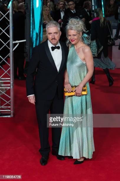 Anthony McCarten and Eva Maywald attend the EE British Academy Film Awards ceremony at the Royal Albert Hall on 02 February 2020 in London England...