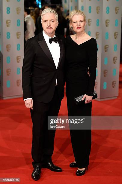 Anthony McCarten and guest attend the EE British Academy Film Awards at The Royal Opera House on February 8 2015 in London England