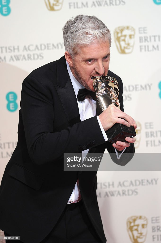Anthony McCarten poses in the winners room at the EE British Academy Film Awards at The Royal Opera House on February 8, 2015 in London, England.