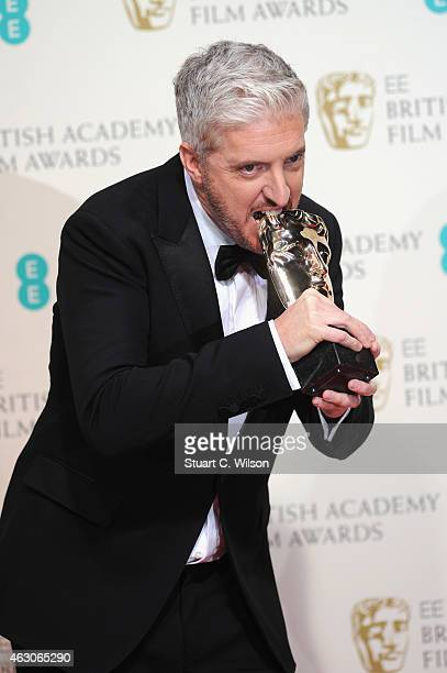 Anthony McCarten poses in the winners room at the EE British Academy Film Awards at The Royal Opera House on February 8 2015 in London England