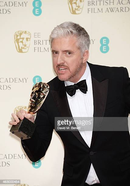 Anthony McCarten winner of Best Adapted Screenplay for The Theory Of Everything poses in the winners room at the EE British Academy Film Awards at...