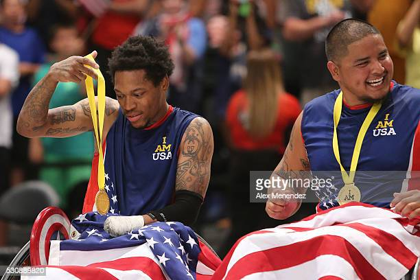 Anthony McDaniel admires his Gold medal against Denmark during the Invictus Games Orlando 2016 Wheelchair Rugby Finals at the ESPN Wide World of...