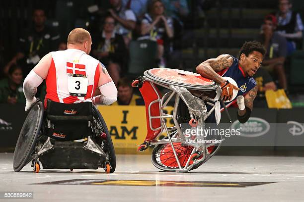 Anthony McDaniel falls over after being hit by Mark Peters of Denmark during the Invictus Games Orlando 2016 Wheelchair Rugby Finals at the ESPN Wide...