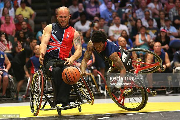 Anthony McDaniel of the United States crashes during action against the United Kingdom the Invictus Games Orlando 2016 Wheelchair Basketball Finals...