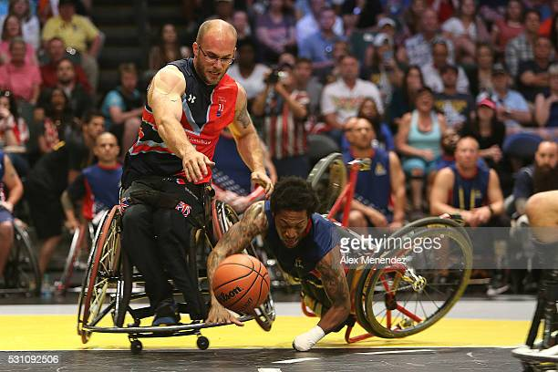 Anthony McDaniel of the United States crashes during action against the United Kingdom at the Invictus Games Orlando 2016 Wheelchair Basketball...