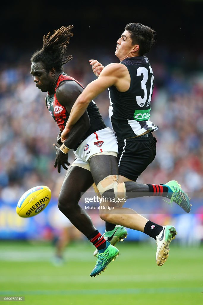 Anthony McDonald-Tipungwuti of the Bombers (L) and Brayden Maynard of the Magpies compete for the ball during the round five AFL match between the Collingwood Magpies and the Essendon Bombvers at Melbourne Cricket Ground on April 25, 2018 in Melbourne, Australia.