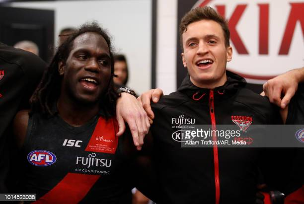 Anthony McDonaldTipungwuti of the Bombers sings the team song with Orazio Fantasia of the Bombers during the 2018 AFL round 21 match between the...