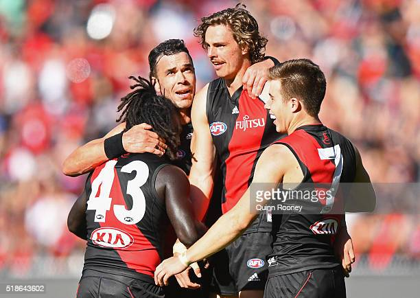 Anthony McDonaldTipungwuti Ryan Crowley Joe Daniher and Zach Merrett of the Bombers celebrate after winning the round two AFL match between the...