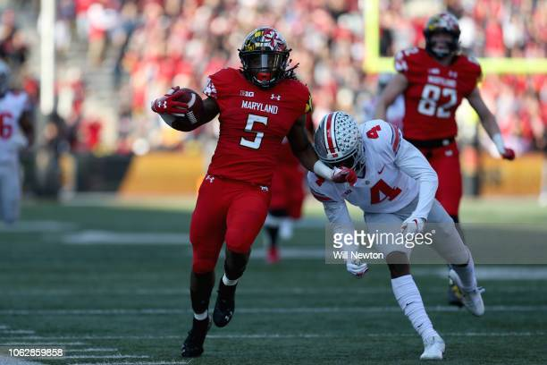 Anthony McFarland of the Maryland Terrapins is tackled by Jordan Fuller of the Ohio State Buckeyes during the first half at Capital One Field on...