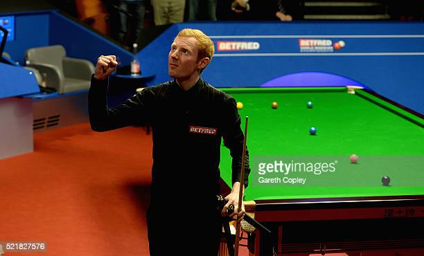 Anthony McGill celebrates beating Shaun Murphy during their first round match of the 2016 Betfred World Snooker Championship at Crucible Theatre on...