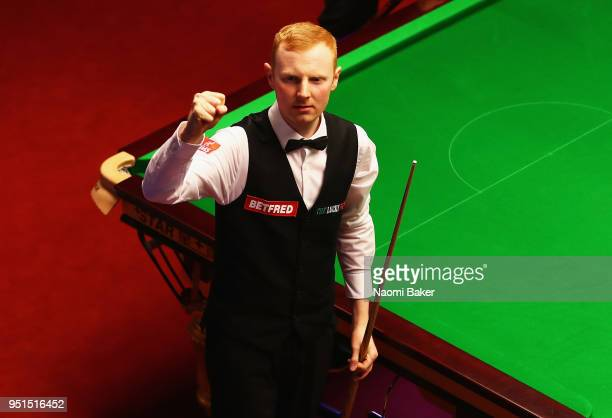 Anthony McGill of Scotland celebrates after winning his first round match against Ryan Day of Wales during day six of the World Snooker Championship...