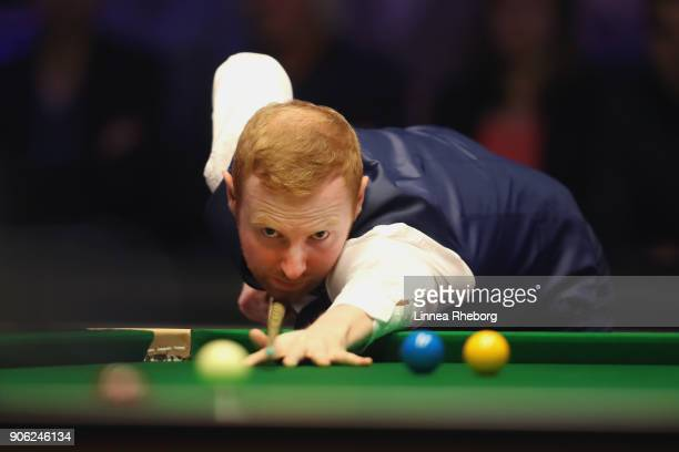 Anthony McGill of Scotland in action during his first round match against John Higgins of Scotland on day four of The Dafabet Masters at Alexandra...