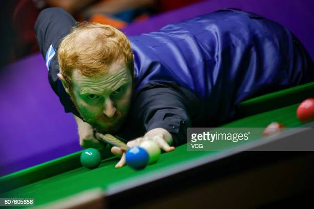 Anthony McGill of Scotland plays a shot against Michael Georgiou of Cyprus and Antonis Poullos of Cyprus on day two of 2017 Snooker World Cup at Wuxi...