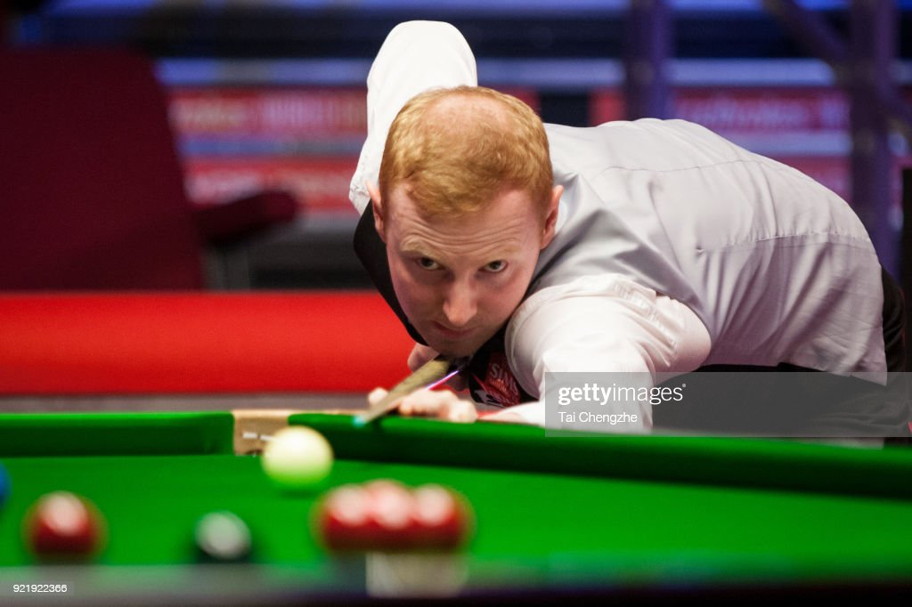 Anthony McGill of Scotland plays a shot during his first round match against Cao Yupeng of China on day two of 2018 Ladbrokes World Grand Prix at Guild Hall on February 20, 2018 in Preston, England.