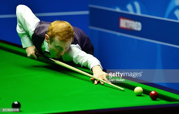 Anthony McGill of Scotland plays a shot during his second round match against Marco Fu of Hong Kong on day six of the World Snooker Championship at...