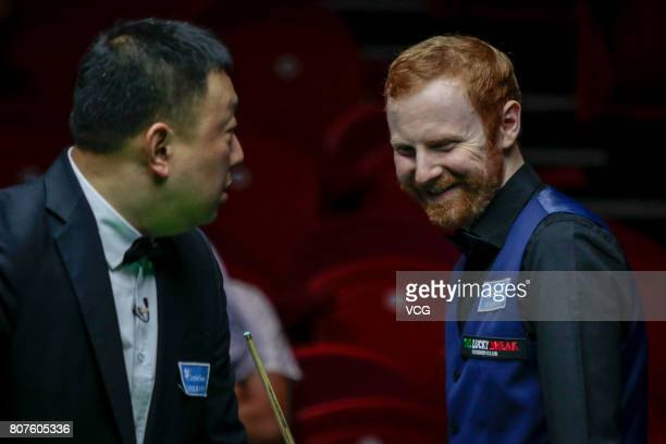 Anthony McGill of Scotland reacts against Michael Georgiou of Cyprus and Antonis Poullos of Cyprus on day two of 2017 Snooker World Cup at Wuxi City...
