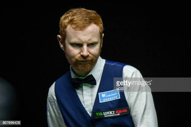 Anthony McGill of Scotland reacts against Thepchaiya UnNooh of Thailand and Noppon Saengkham of Thailand on day one of 2017 Snooker World Cup at Wuxi...