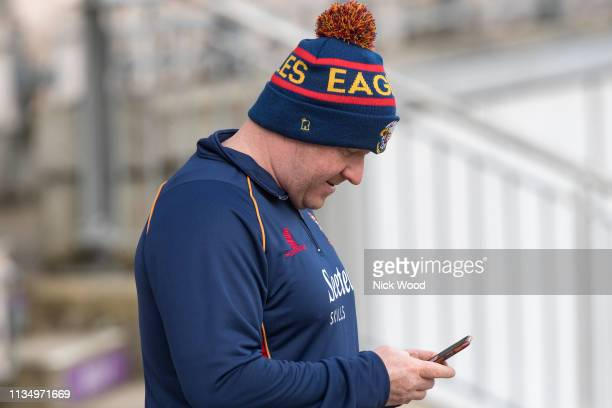 Anthony McGrath head coach of Essex stares at his phone prior to the Hampshire v Essex Specsavers County Championship match on April 5 2019 in...