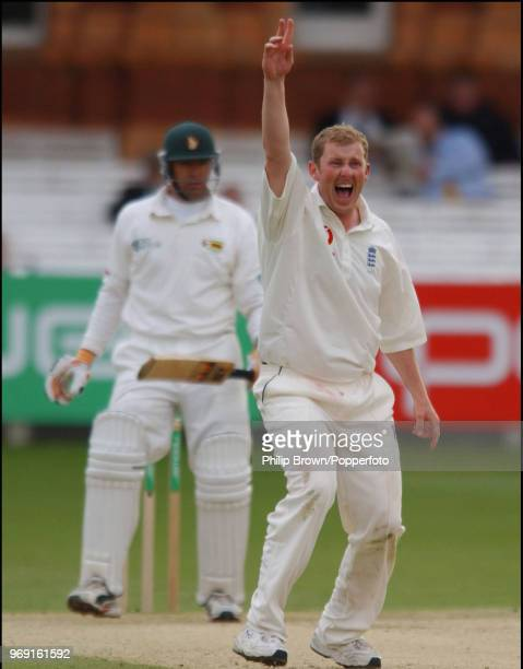 Anthony McGrath of England claims the wicket of Zimbabwe captain Heath Streak, LBW for 11 runs, during the 1st Test match between England and...