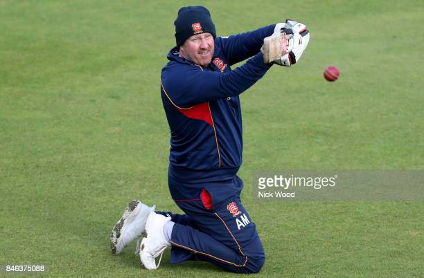 Anthony McGrath of Essex directs the ball during slips drills prior to the Warwickshire v Essex Specsavers County Championship Division One cricket...