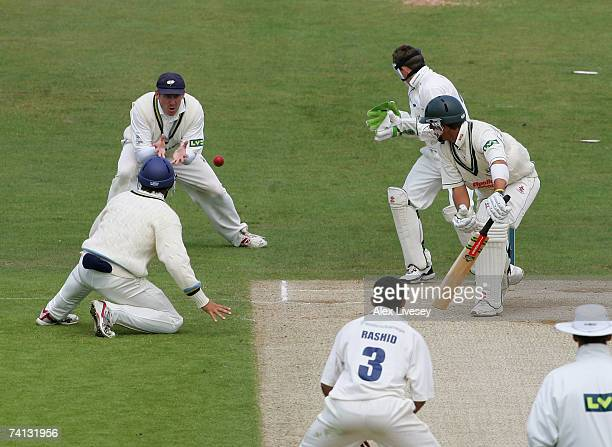 Anthony McGrath of Yorkshire catches the ball off Adil Rashids delivery to take the wicket of Roger Sillence of Worcestershire during the LV County...