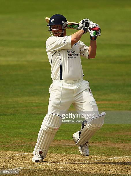 Anthony McGrath of Yorkshire hits the ball towards the boundary during the LV County Championship match between Lancashire and Yorkshire at Old...