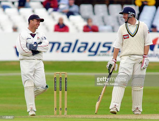Anthony McGrath of Yorkshire shares a joke with Lancashire wicket keeper Warren Hegg during the Yorkshire v Lancashire Frizzell County Championship...