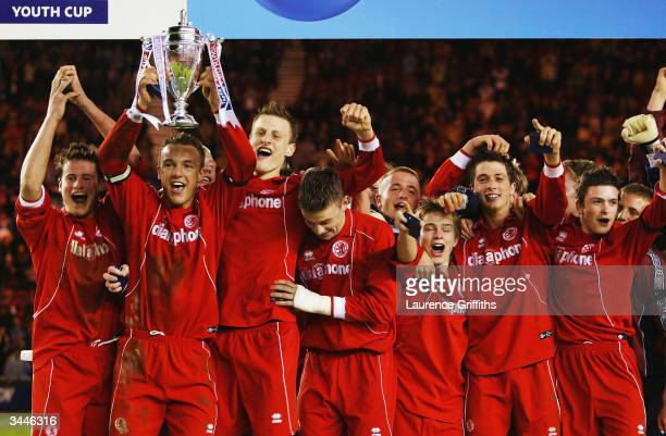 Anthony McMahon of Middlesbrough holds the Cup aloft with his team after winning the FA Youth Cup Final, 2nd Leg match between Middlesbrough and...