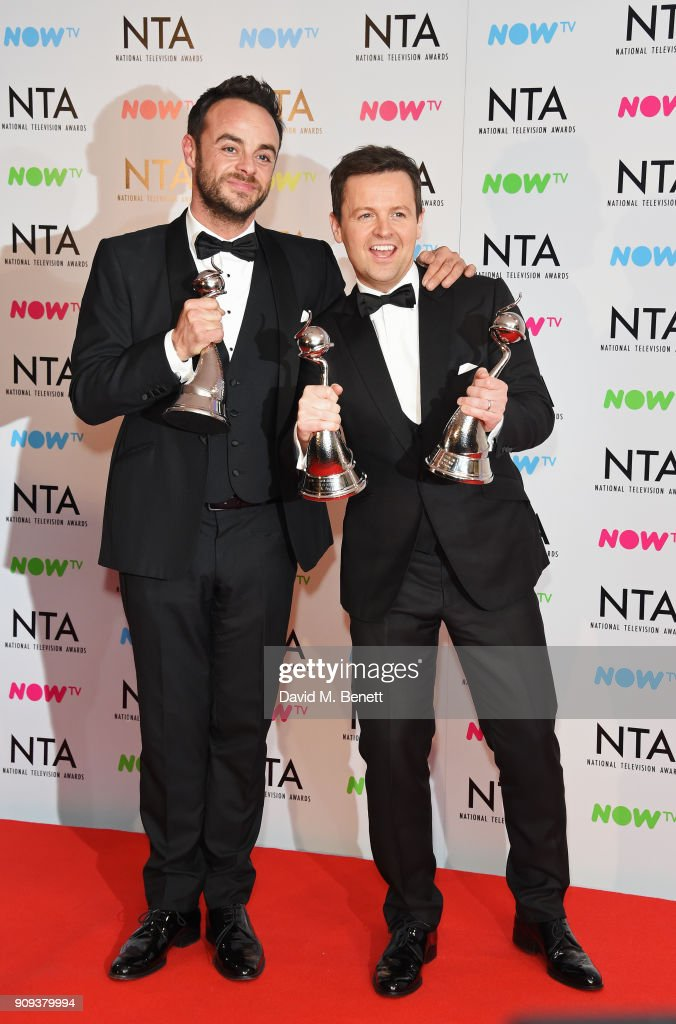 Anthony McPartlin (L) and Declan Donnelly aka Ant & Dec, winners of the TV Presenter award and The Bruce Forsyth Entertainment Award, pose in the press room at the National Television Awards 2018 at The O2 Arena on January 23, 2018 in London, England.